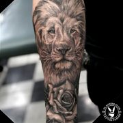Lion and Rose Tattoo Hall Sleeve Tattoo in Black and white.