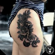 Sexy Snake and roses tattoo on the girls thigh